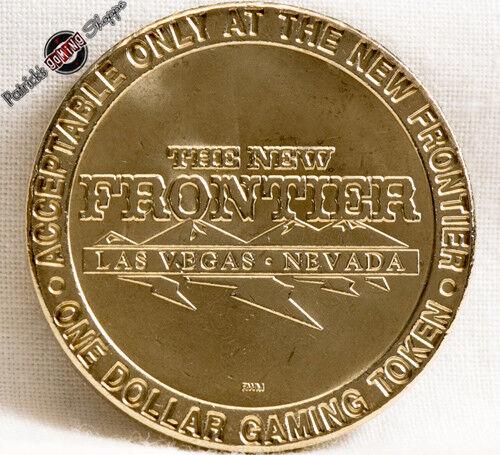 $1 BRASS SLOT TOKEN COIN THE NEW FRONTIER CASINO 1998 RWM MINT LAS VEGAS NEVADA