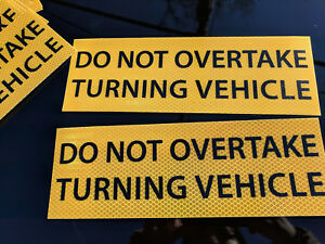 Do-Not-Overtake-Turning-Vehicle-REFLECTIVE-2-STICKERS-Sign-300x100mm-COMPLIANT