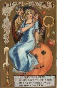 Halloween-Beautiful-Woman-w-Mirror-Sitting-on-JOL-c1910-Postcard