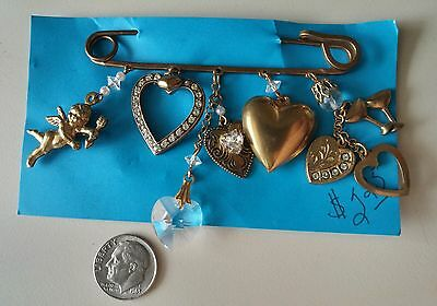 Gold tone Valentine's Day pin/brooch with dangling charms