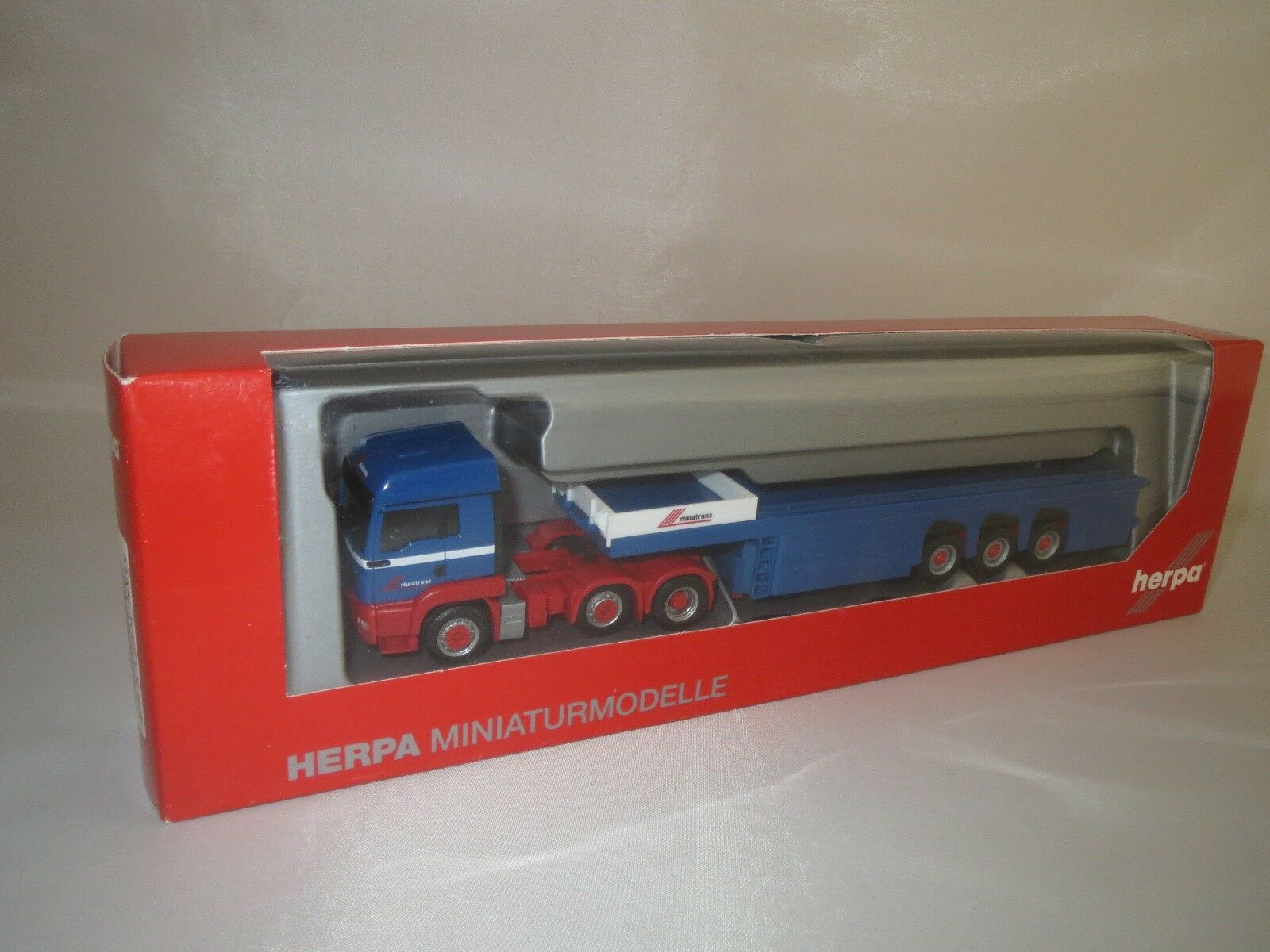 Herpa  155618  MAN  TGB LX  BeTrS  (blue red)  1 87  OVP