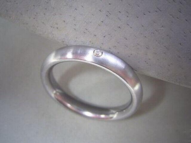 Asymetricher Spannring mit Zirkonia Ring aus Edelstahl mit weißem Zirkon