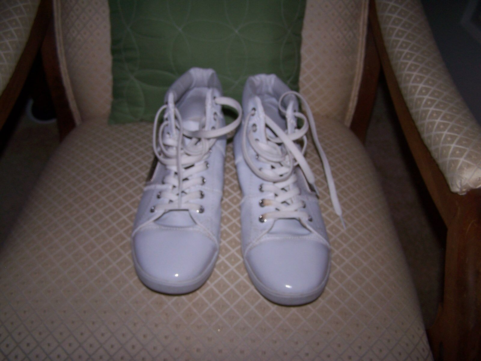 White Tennis shoes Men's brand is unknown Metal tag on side says Limited Edition