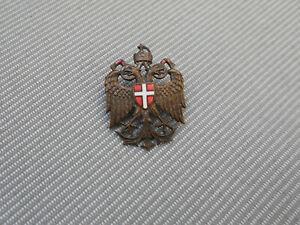 K.u.k. Kappenabzeichen aus Österreich in Abbildung des Adlers aus Österreich