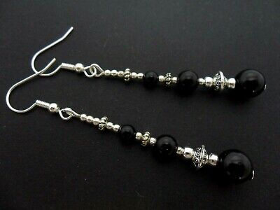 A PAIR OF DANGLY BLACK ONYX PEARL  SILVER PLATED LEVERBACK HOOK   EARRINGS.