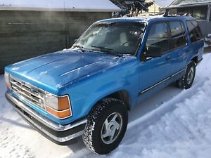 2 Ford Explorers