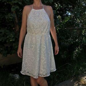 Brand H/&M. Second hand white large lace collard sleeveless short dress