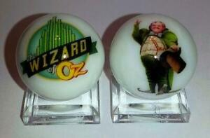 """Nice Set of 2 Wizard of Oz Glass 1/"""" Logo Marble With Stands"""