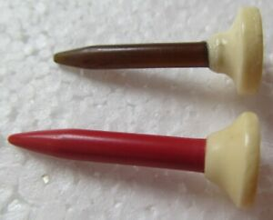 2-VINTAGE-CELLULOID-GOLF-TEES-WITH-A-RED-STEM-AND-A-BLACK-STEM-VERY-UNUSUAL