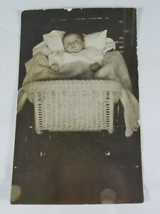 Vintage-Real-Photo-Post-Card-Baby-With-Ring-in-Wicker-Bassinet-AZO-1910-039-s