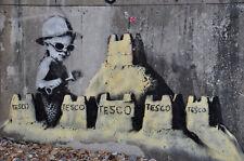 Framed Print - Banksy Street Art Boy with Tesco Sandcastles (Graffiti Picture)