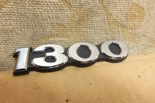NOS GENUINE MAZDA FAMILIA 1300 SEDAN 1972-75 EMBLEM SCRIPT BADGE # 0488-69-076