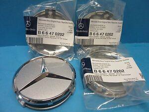 4 genuine wheel hub cap mercedes benz star oem 2204000125 for Silver star mercedes benz parts
