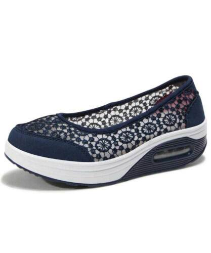 Women's navy low cut slip on rocker bot sole shoe sneaker floral lace design