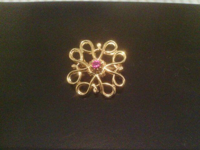 Avon long service gold tone faux ruby pin