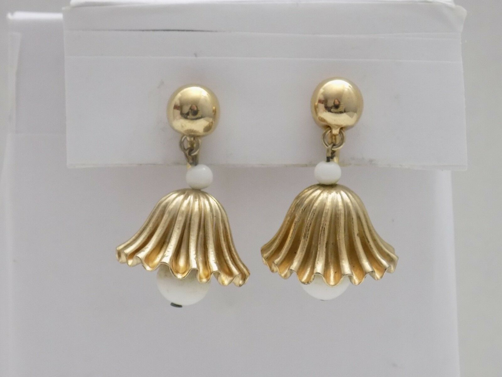 Vintage Signed NAPIER gold Tone with White Glass Beads Dangle Bell Clip Earrings