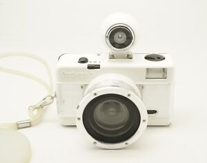 Lomography-Used-White-Silver-Fisheye-2-35mm-Film-Camera-in-Good-Condition