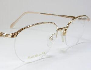 Rimless Eyeglasses With Rhinestones : Stunning! Charmant Gold 100% Titanium Womens Rimless Dress ...