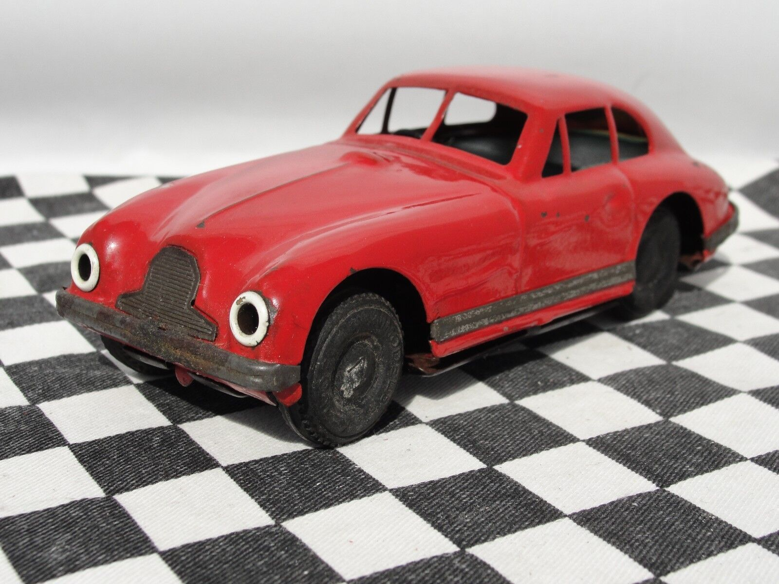 MINIMODELS 1950'S TINPLATE ASTON MARTIN RED  1.32  USED UNBOXED