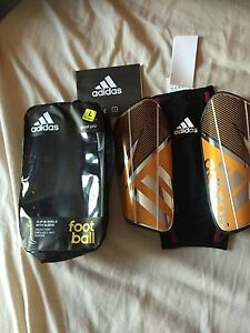 adidas slip on shield with sleeve