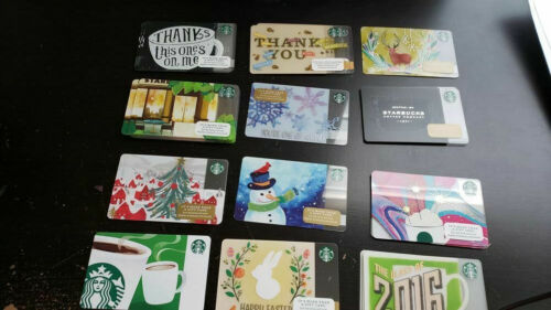 misc cards with pin intact//stickers Starbucks Cards