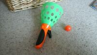 green plastic ball catcher game