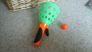 green-plastic-ball-catcher-game
