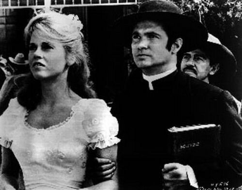 Cat Ballou Looking Serious in Black Suit and White Dress High Quality Photo