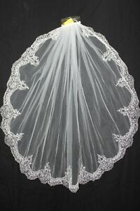 New! White single layer fingertip length veil with embroidered edge, $175