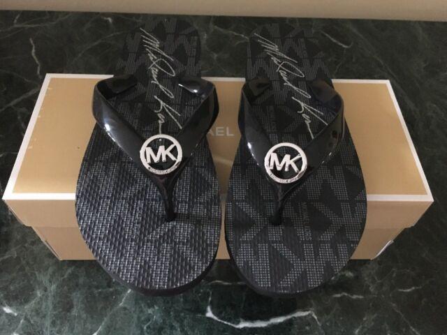 21af128701e0 Michael Kors Jet Set Rubber Flip Flop Logo Black Silver Sandal Size ...