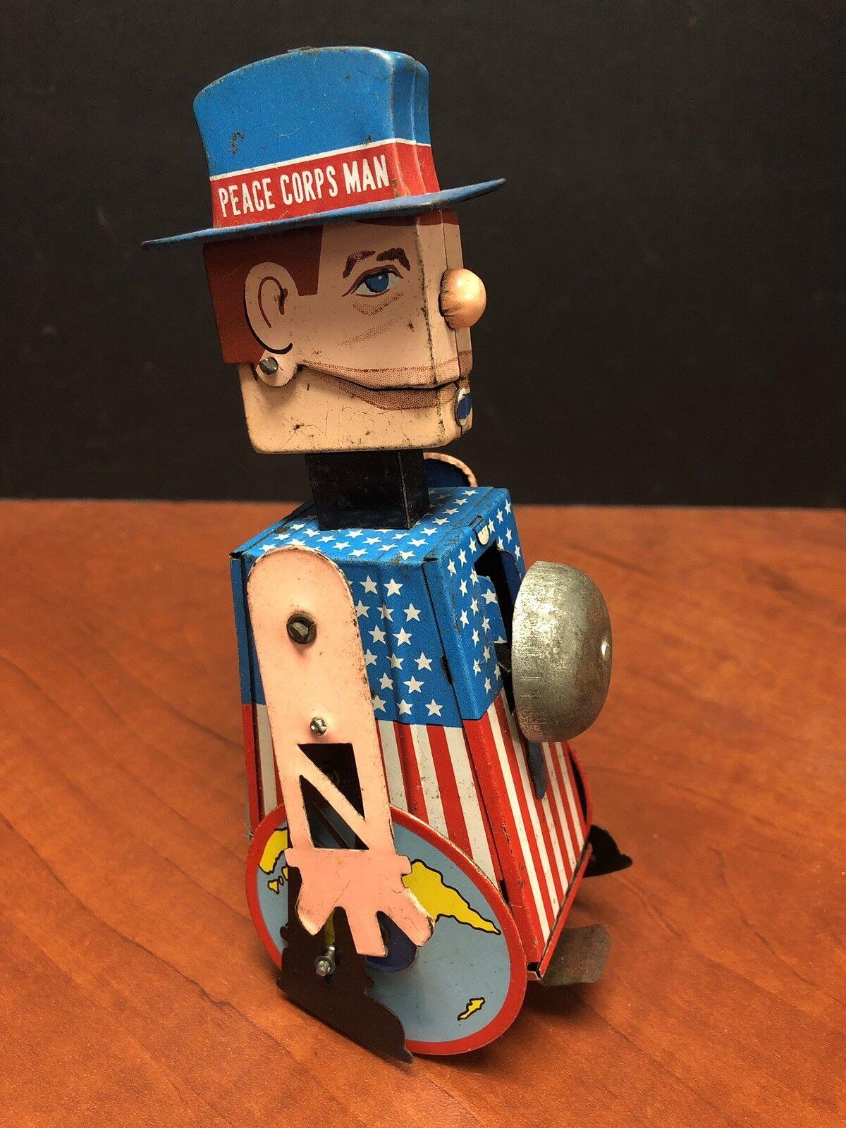 Vintage Japan Tin resaing Sam Peace Corps Man Wind Up Toy Works EM2113