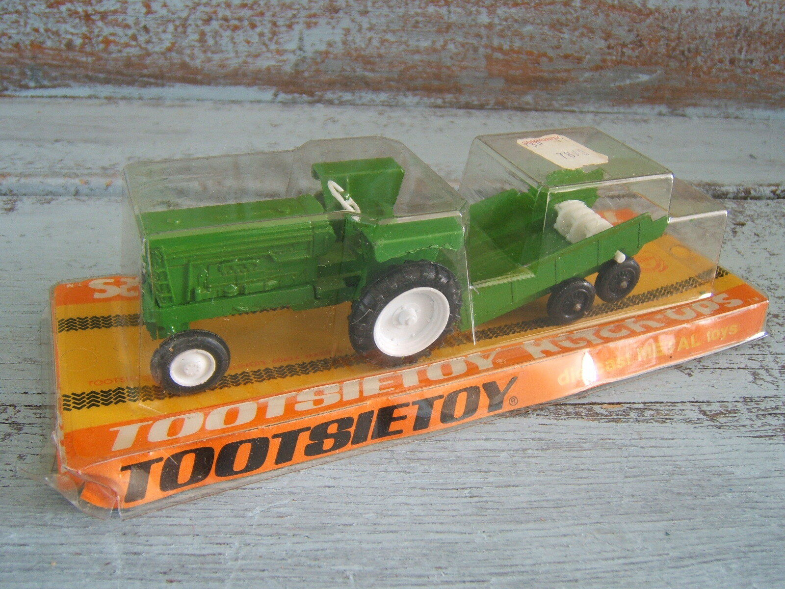 Vintage 1969 Tootsietoy Hitch Ups Green Farm Tractor & Spreader on Sealed Card