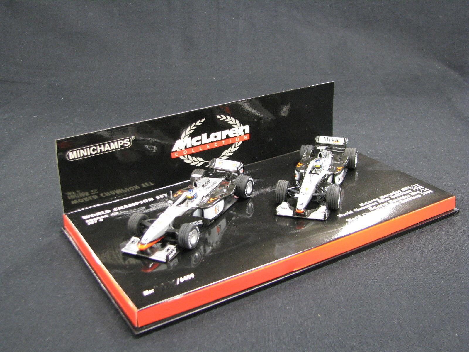 Minichamps McLaren Mercedes MP4 13   McLaren Mercedes MP4 14 1 43 Hakkinen