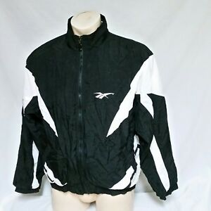 a962f46cf0236 Details about VTG Reebok Windbreaker Jacket Spell Out Big Logo Coat 90s  Sport Track Ski Large