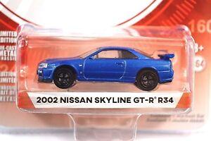 Nissan-Skyline-GT-R-R34-2002-bleu-Tokyo-couple-Ser-1-29880-E-1-64-Greenlight