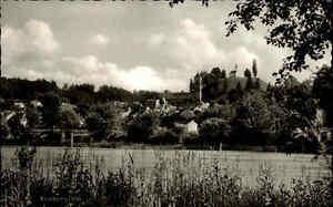Kraiburg-am-Inn-Bayern-s-w-AK-und-Stempel-aus-1963-Gesamtansicht-mit-Bergkapelle