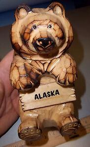 Alaska-Carved-Wood-Bear-sitting-holding-sign-with-Alaska-on-it-great-knick-knak