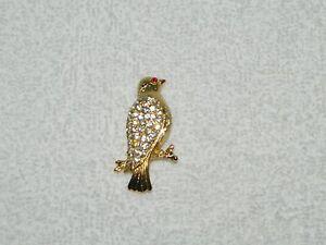 Lovely-Goldtone-amp-Clear-Rhinestone-Bird-on-a-Branch-Brooch-Pin-w-Red-Eye