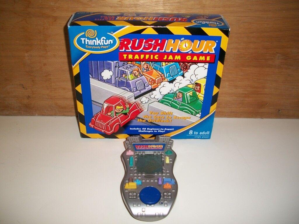 THINK FUN RUSH HOUR TRAFFIC JAM GAME & ORIGINAL HANDHELD TRAFFIC JAM GAME RADICA