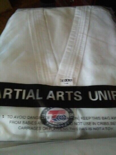 White Student Martial Arts Uniform  Taekwondo size 2