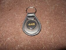 OLDSMOBILE 442 4-4-2 GOLD BLACK LOGO 1986 1987 1970's KEYCHAIN KEYRING BLACK