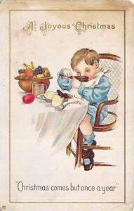 Joyous-Christmas-c1915-Postcard-Boy-Eating-Meal-Christmas-But-Once-A-Year