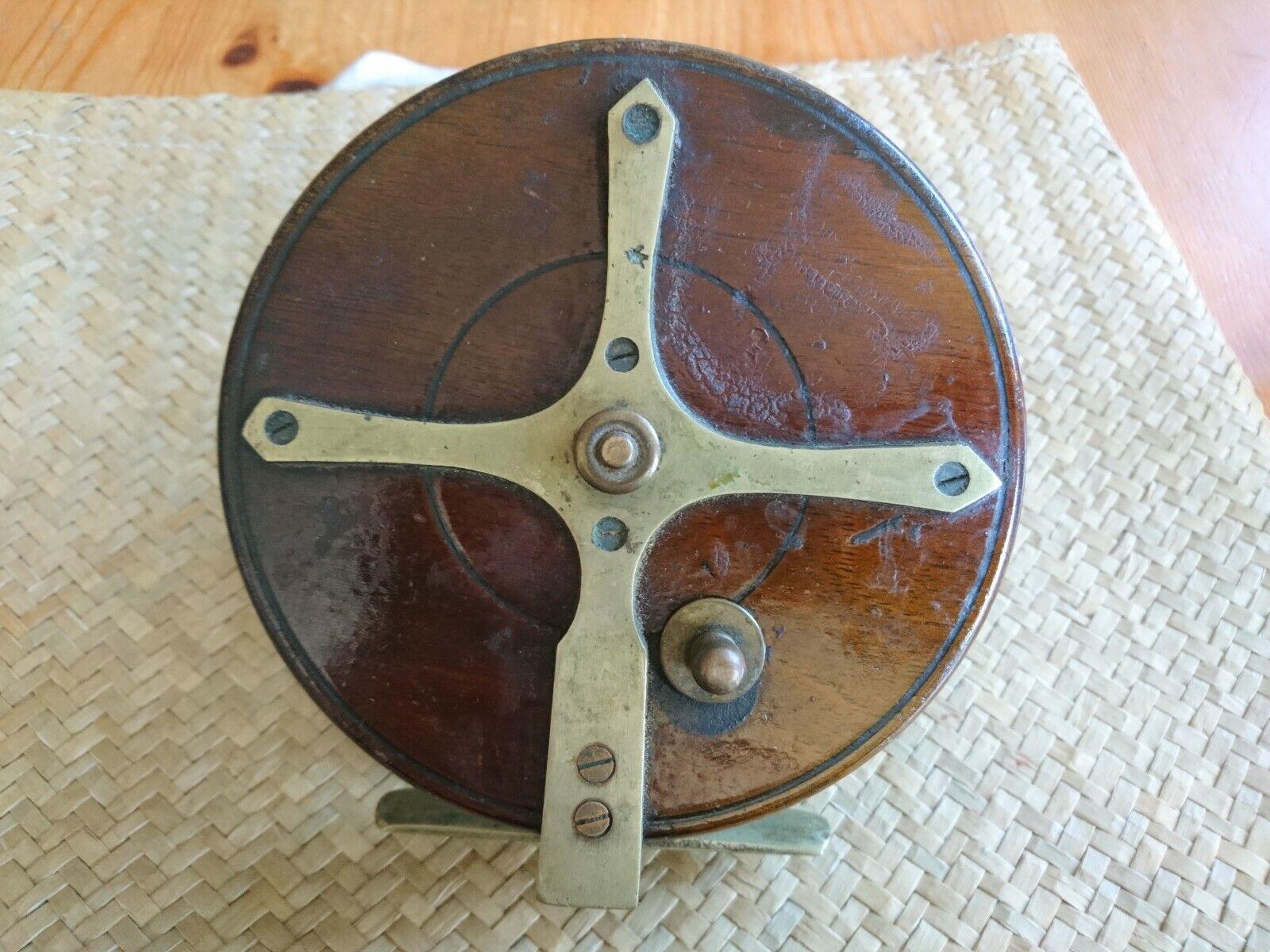 Vintage 5  wood Starback Fishing Reel, Ratchet. Brass backed spool