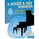 A Dozen a Day Songbook: Pop Hits: Book 1 by Music Sales Ltd (Mixed media product, 2012)