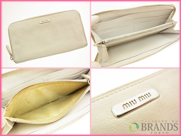 miumiu Wallet Purse zipper wallet Logo White Woman Authentic Used R441