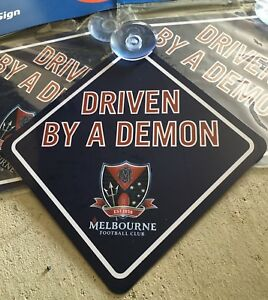 AFL-Melbourne-Demons-CAR-WINDOW-SIGN-WITH-SUCTION-FOOTBALL-new-sign-cars