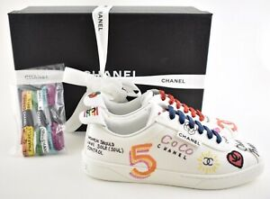 ab5f600c8 Chanel X Pharrell 19D White Graffiti CC Low Top Lace Up Flat Trainer ...