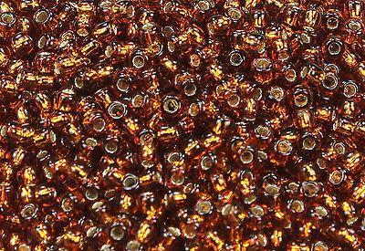 11/0 Round Toho Japanese Glass Seed Beads #34-Silver-Lined Smoky Topaz 15 grams