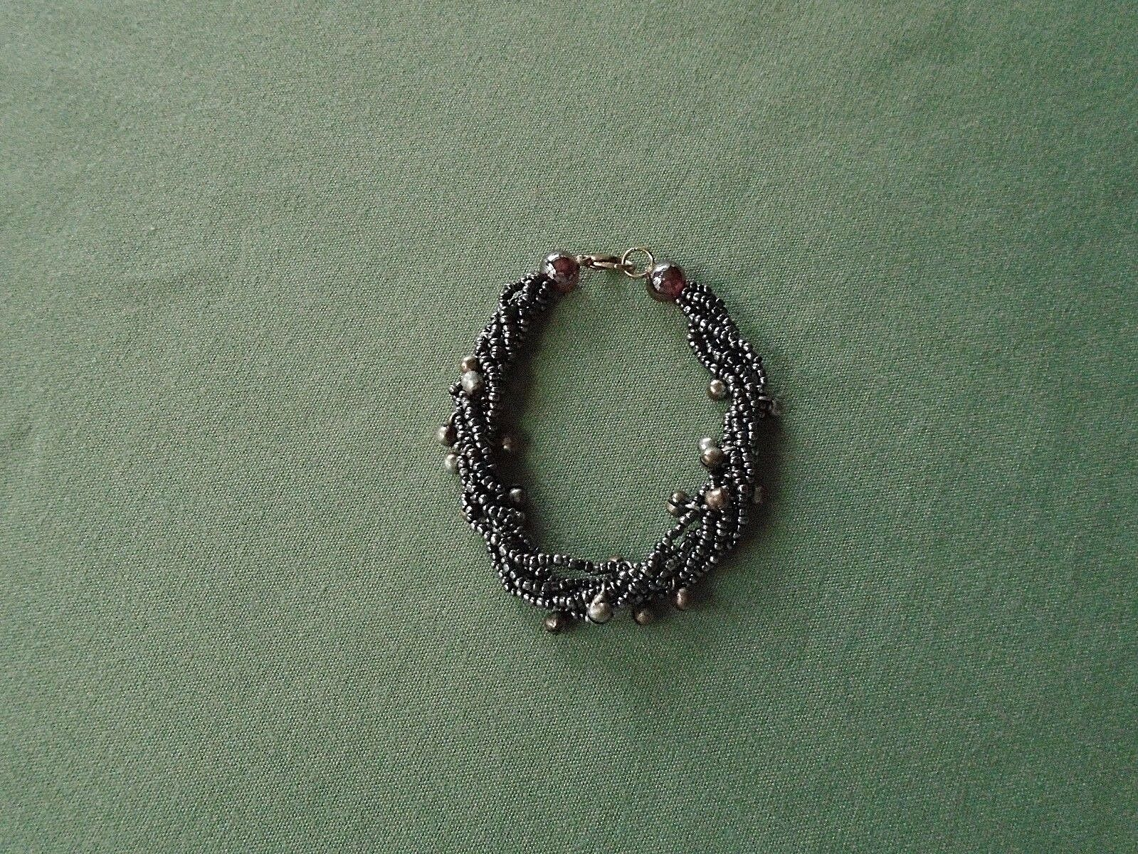 Bracelet 6 strand black hematite and crystal with arrow an heart toggle clasp.