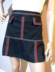 CUE-sz-10-a-line-stretch-SKIRT-with-pockets-and-contrast-geeometric-pattern-trim